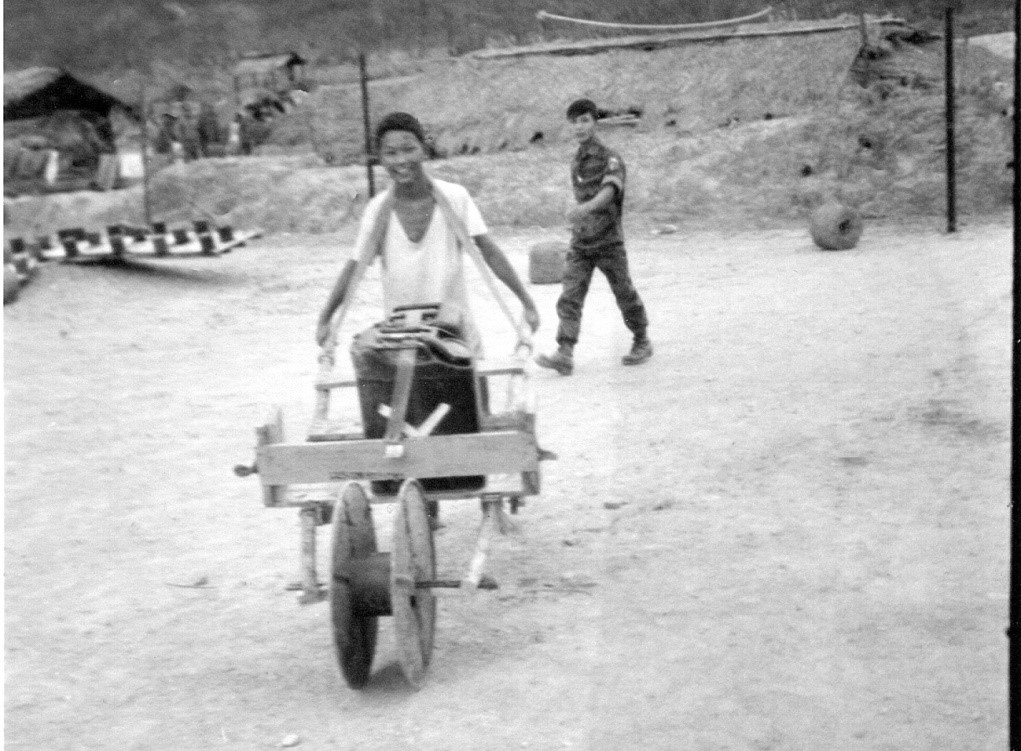 One of our two Vetnamese teenage prisoners with his handmade wheelbarrow.