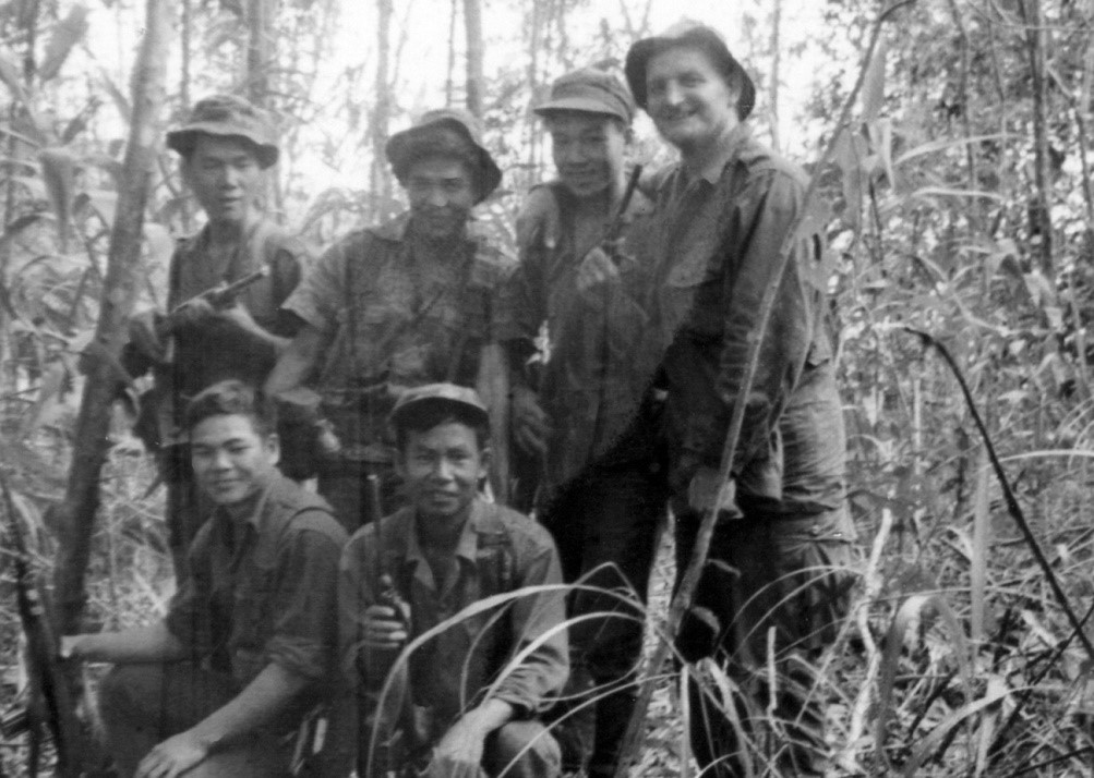One of our Australian Warrant Officers with several Chinese Nungs, and one of the interpreters (no hat)—somewhere in the Ashau Valley of South Vietnam.